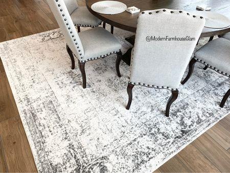 The best neutral affordable dining room rug! Dining room at ModernFarmhouseGlam  Dining room chairs Round farmhouse wooden tables white rug black rug distressed rug   #LTKsalealert #LTKhome