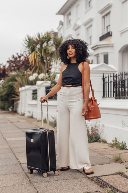 Black and white monochrome outfit  and black suitcase for easy, chic travel outfit.   #LTKSeasonal #LTKeurope #LTKstyletip