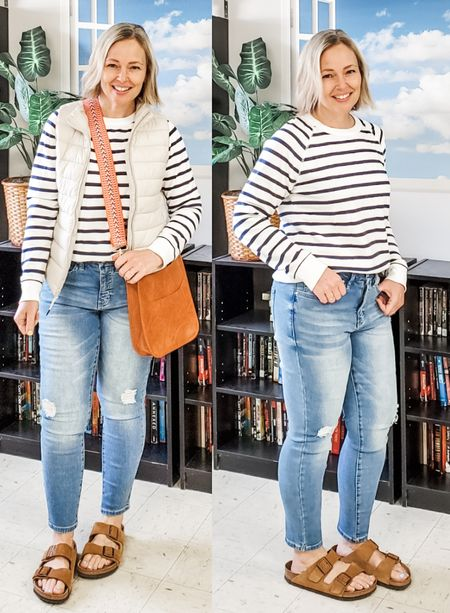 Casual everyday spring weekend teacher outfit featuring a striped pullover sweatshirt, skinny curvy high rise waist jeans, Birkenstocks, and a crossbody vegan leather messenger bag with strap. #teacher #jeans #skinnyjeans #stripedsweater #stripedsweatshirt #stripes #puffervest #socialthreads #birkenstock #petite #spring #midsize #Lifestyle #weekend http://liketk.it/3dAJ8 @liketoknow.it #liketkit
