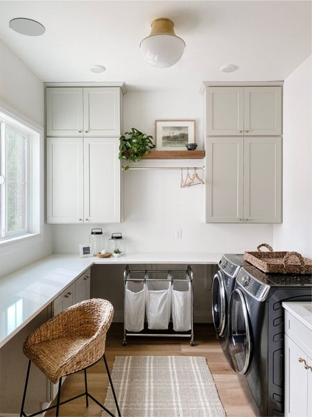Laundry room reveal. Come follow me on IG @lindseypedey  Laundry room decor, laundry room design, floating shelves, counters tool, rolling laundry, washer dryer, front load, brass hardware, McGee and co, brass light, semi flush mount  #LTKsalealert #LTKhome #LTKunder50