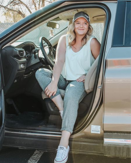 My favorite fabletics set for traveling! Wearing a medium in both the top and bottoms.  Travel outfit, comfy travel clothes, jogger set, crop tank, athleisure, workout clothes, adidas hat, mom style, easy outfit.   http://liketk.it/3hWZ3 #liketkit #LTKfit #LTKsalealert #LTKstyletip @liketoknow.it