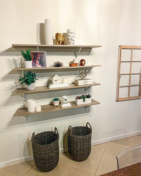 This 4 shelf decor display is my pride and joy now. I love the white and gold decor pieces on these shelves. It gives a very clean look. The faux plants are amazing to display as well. The brown display baskets just finish the look. You can instantly shop all of my looks by following me on the LIKEtoKNOW.it shopping app #homedepot #homegoods #decor #homedecor #homedecorpieces #whitedecor #golddecor #StayHomeWithLTK #LTKhome http://liketk.it/350Rw #liketkit @liketoknow.it