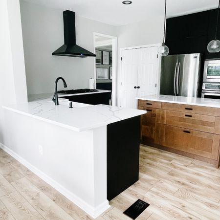 Kitchen renovation, black cabinets, faucet, farmhouse sink, hood range, stove top, IKEA kitchen   #LTKhome #LTKstyletip
