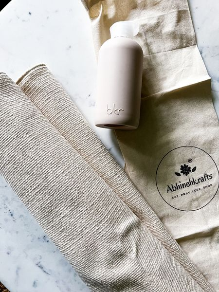 This organic cotton yoga mat is by an India-based boutique called Abhinehkrafts.  It is made from recycled materials and handwoven in India.  They also use carbon neutral shipping.  It has anti skid grips and comes in multiple colors.  It is a beautifuyl gift and even better when paired with this Bkr water bottle.  It's women owned and operated and the bottle is made from soda lime glass and is recyclable. #ecofriendly   #LTKGiftGuide