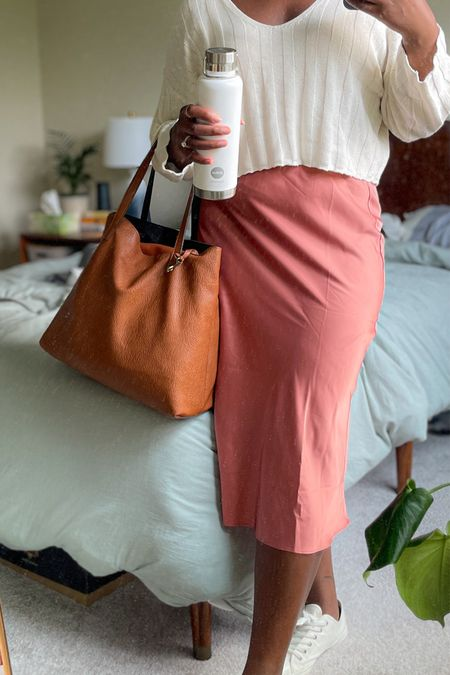 Summer office outfit. Slip skirt, cropped sweater, brown tote, and white sneakers. Work appropriate casual outfit   #LTKcurves #LTKworkwear
