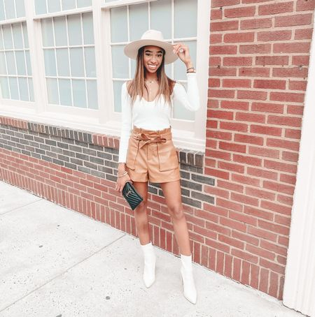 Lane 201 boutique brown leather shorts and this cute white top. It's so flattering on. I also love these Steve Madden boots   #LTKunder50 #LTKshoecrush #LTKsalealert