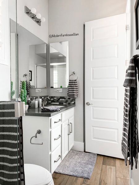 I get a lot of requests to see some of our secondary bathrooms, so here's a peel at my son's bathroom, with a refresh from @walmart ! #sponsored I like making the kids' spaces feel warm and welcoming for them and he's loving the new masculine, cozy towels, rugs, & accessories. Now let's see how long he'll keep it clean lol!🤦🏻♀️ Anyone else relate?😂  I linked the new Walmart Gap Home Collection ombre bath rugs, organic grey striped cotton towels, and ombre bathroom accessory set in my stories, on my blog at www.modernfarmhouseglam.com and on the LTK app! Do you follow me there? You can get all of my sources for free and it doesn't cost you anything extra to use my links. @ltk.home @shop.ltk #ltkhome #liketoknowit #ltk   #WalmartHome #bathroomdesign #bathroomremodel #bathroom #bathroomdecor #bathroomvanity #bathroomtiles #gaphome  #bathroomorganization #bathroominspo #bathroomrenovation #bathroomideas #bathroominspiration #bathroomstyling #homeinspo #interiordesign #modernbathroom #masculinebathroom #fixerupper #diyhome #homeimprovement #homerenovation #modernfarmhouseglam   #LTKfamily #LTKsalealert #LTKhome