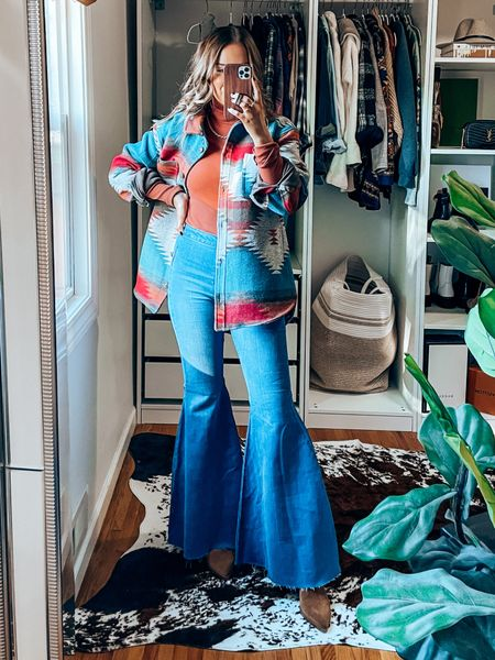 70s inspired fall outfit featuring Aztec design shacket, rust turtleneck, flare jeans - s in tops, 26S in flares, size up .5 in booties!   #LTKSeasonal #LTKshoecrush #LTKunder100