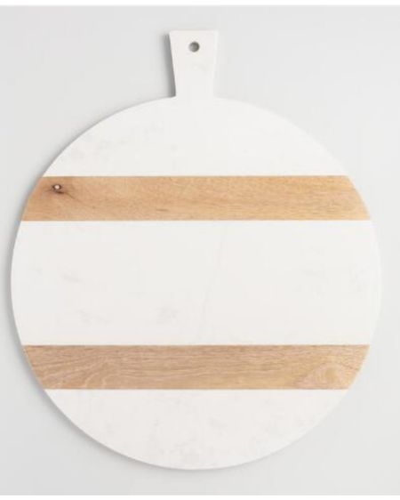 The famous round wood and white cutting board. Makes a statement decor piece when displayed in the kitchen. http://liketk.it/38NCv #liketkit @liketoknow.it #StayHomeWithLTK #LTKunder50 #LTKfamily @liketoknow.it.home @liketoknow.it.family Follow me on the LIKEtoKNOW.it shopping app to get the product details for this look and others