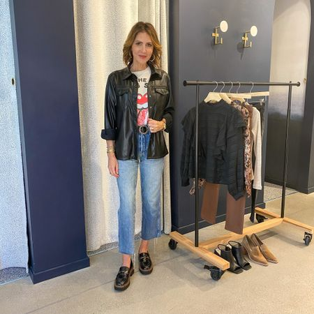 In love with this casual chic look from @evereveofficial. This pleather Shacket works great with the graphic tee and high waisted cropped jeans. These Sam Edelman loafers complete the whole look.   Casual chic look, denim style, leather Shacket, rolling stone graphic tee, black lug sole loafers, Sam edelman loafers  #LTKstyletip #LTKshoecrush #LTKunder100