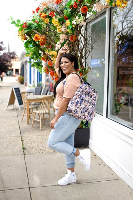 """Vera Bradley new print in tangier paisley + new fall favorites! Use code """"queencarlene"""" for 10% off   Shirt is aerie (L), jeans are seven (31, TTS), & shoes are converse (size down 1.5 sizes)  Vera Bradley collection, travel essentials, #verabradley, travel must-haves, backpacks, floral bags, Vera Bradley travel, casual style, midsize, mid size, aerie, light denim jeans, converse, high rise denim, size 12, size 14, high tops   #LTKcurves #LTKstyletip #LTKtravel"""