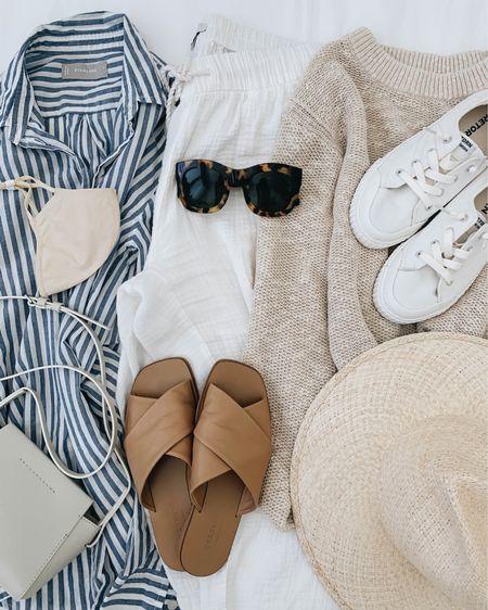 Easy beach days. Beachwear. Coverups. What to wear to the beach  Shirt - Everlane 2 Pants - Madewell xxs Sweater - Everlane xs Sandlas - Everlane 5 Sneakers - Tretorn 5 Hat - Janessa Leone Bag - Everlane (old) Sunglasses - Anine Bing (old)  http://liketk.it/3hSVW #liketkit @liketoknow.it #LTKswim