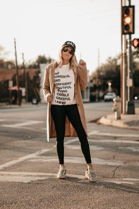 Graphic sweatshirt with a camel coat and leather leggings ✔️  #LTKSeasonal #LTKstyletip #LTKunder100