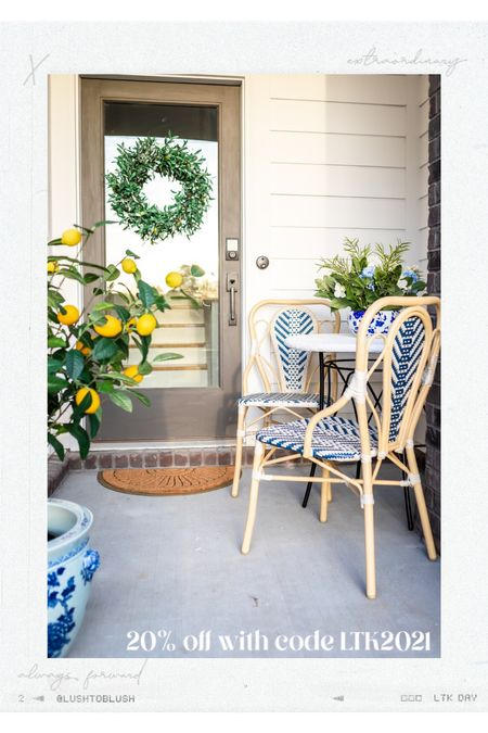 My favorite outdoor dining chairs! The pretty pattern comes in so many color selections - I went with blue! Looks so great with the faux lemon tree and olive wreath! Perfect for spring and summer 😊   #LTKhome #LTKSeasonal #LTKsalealert