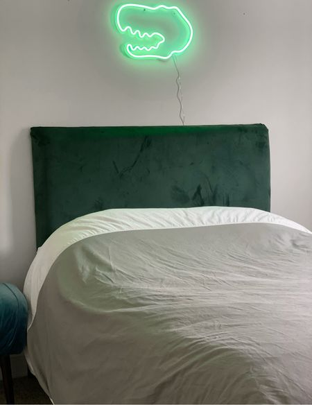 Upgrading Toby's room a little at a time… I made this really easy headboard with a canvas frame, a strip of thin foam, and a luxury green velvet fabric that I picked up @hobbylobby #diying   Then I ran across this cool neon light and thought it would add a fun and playful element to his room 🦖  Linked more boy room ideas on my @shop.ltk app     #LTKkids #LTKunder50 #LTKhome