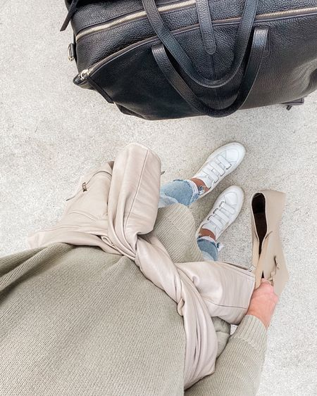 This Abercrombie faux leather moto is so good, and I love my Vejas for a comfortable travel day. Exact color sold out, two in-stock pairs I love for fall linked! #cuyanabags #vejavlock #vejasneakers #falltraveloutfits #airportoutfitfall
