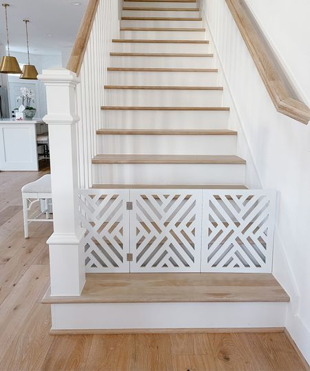 We got this stair gate to prevent Teddy from going upstairs, and it's great for smaller dogs and so aesthetically pleasing! Please note this is not for children as it does not bolt into the wall.   I've linked a kid safe option that yiu can have custom made for your stairs!  #LTKhome