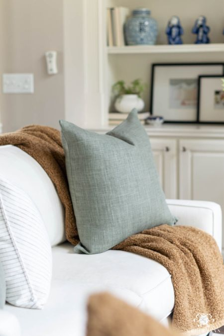 Light green and warm brown are prominent in my living room fall decor. Home decor living room decor green living pillows teddy bear throw pottery barn sofa white sofa built in   #LTKSeasonal #LTKstyletip #LTKhome