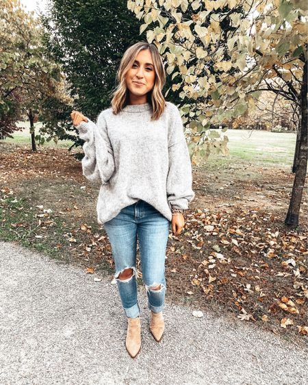 Feeling like Christmas came early because my favorite ripped jeans are HALF OFF today and under $50! And my favorite earrings are 25% off when you spend $100. Also, I don't like to play favorites with my sweaters but this is the dreaaaaamiest oversized sweater I own.   Shop all my looks in the LIKEtoKNOW.it app! Simply download the app, give me a follow or screenshot one of my IG pictures to shop! http://liketk.it/2G9Bd #liketkit @liketoknow.it