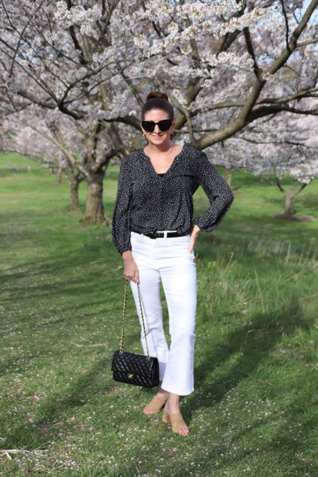 """I've been loving my Fleetwood wash Madewell Cali demi boot cut jeans so much that I just ordered them in white! They fit true to size and pass the """"no see through"""" test. Paired them here with a black and white leaf print popover and black accessories for a classic look. Chanel bags are an investment but hold their value well! Linked some look for less options.  http://liketk.it/3dFP6 @liketoknow.it #liketkit #LTKstyletip #LTKitbag Download the LIKEtoKNOW.it app to shop this pic via screenshot"""