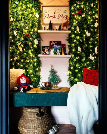 My girls are loving their Christmas decorated reading nook! The fairy lights, white fur throw, red sweater pillow, faux greenery, and book ledges are the perfect combination for holiday snuggles. Don't miss the Christmas countdown scrolls tucked into the faux plant wall. #LTKhome #LTKfamily #LTKkids http://liketk.it/33qWq @liketoknow.it #liketkit