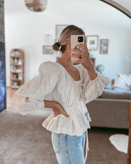 A favorite new puff sleeve blouse. It's made of the prettiest material! Size up because it runs small.