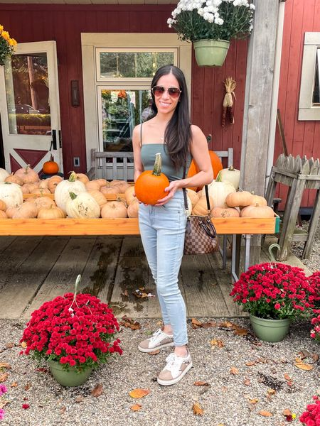 Squeezed some fall fun into our busy weekend. 🎃🖤 My top and jeans are both from Express.   #LTKshoecrush #LTKSeasonal #LTKunder50