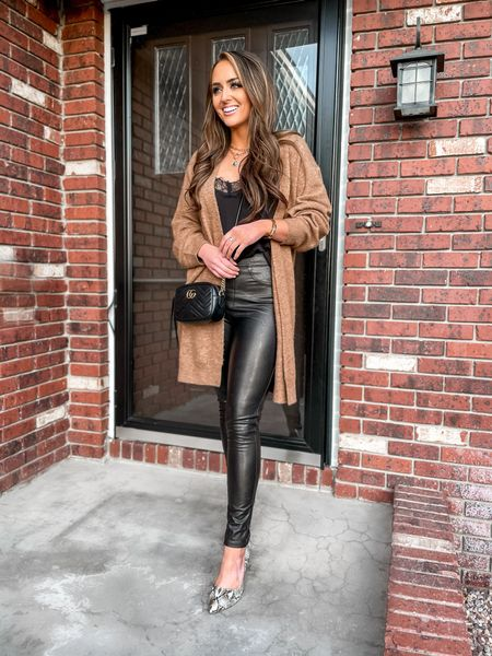These Spanx Leather-Like Ankle Skinny Pants are my new go-to for liters by any outfit! 😍 Wearing size medium, regular length and I'm 5'5.  • Faux-leather pants. Black lace cami. Cozy cardigan. Snakeskin heels. Winter outfits. Gucci Crossbody.  #LTKsalealert #LTKunder100 #LTKstyletip