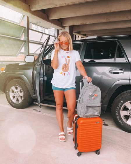 out of office ✌🏼 kinda loving the oversized tee + biker short trend! Linking my Lulu's + Birks plus an Amazon version of each!   Also this carryon has literally been around the world with me. Best affordable suitcase EVER. @liketoknow.it #liketkit http://liketk.it/3gPML #LTKtravel