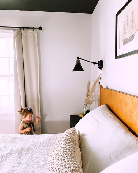 Ceiling and nightstand colors are Vintage Frame by Valspar. Wall sconces, bed frame, and area rug linked. http://liketk.it/2S3VA #liketkit @liketoknow.it #LTKunder100 #LTKhome #LTKsalealert
