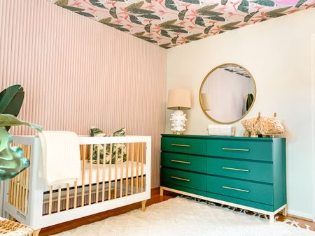 This angle of baby girl's nursery is one of my favorites! I love the ikea dresser hack. The exact dresser used was the ikea malm dresser but I linked an almost identical one from amazon.   #LTKhome #LTKbump #LTKbaby