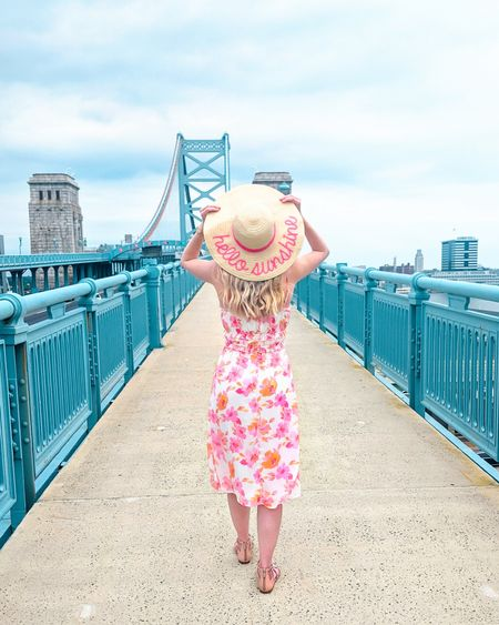 Summer floral dress from Francesca's. Orange and pink floral print with ruffled empire waist. Adjustable spaghetti straps. Recommend sizing down 1 size. Hello Sunshine straw hat. Summer dress, beach dress, vacation dress, travel outfit, vacation look. http://liketk.it/3i19c @liketoknow.it #liketkit #LTKstyletip #LTKunder50 #LTKunder100 #LTKtravel
