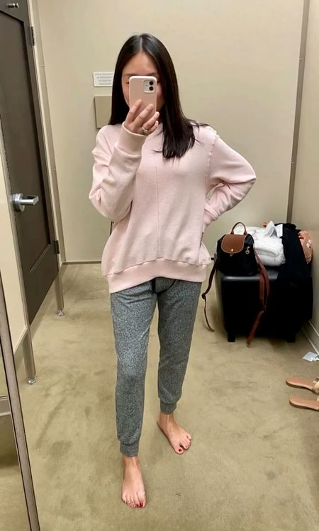 """Trying both the sweatshirt and pants in XS. I'm 5' 2.5"""" and 113 pounds. The sweatshirt has a weird slouch on the sides that isn't flattering. The sweatpants gave me an odd crotch in front (due to the awkward rise) and they also weren't flattering from behind either."""