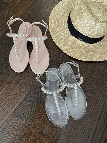 beach vacation outfits // chic sandals that are waterproof for the pool, splash pads but also look great with dresses and nicer outfits   •Stuart Weitzman Goldie Jelly Sandals size 5. Shown in poudre and clear but also come in black and white!  •Brixton Joanna straw sun hat size S - great everyday hat    #LTKshoecrush #LTKSeasonal http://liketk.it/3iOAA #liketkit @liketoknow.it
