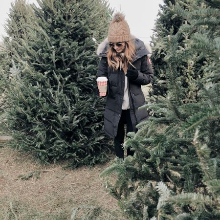 Growing up in Pennsylvania, we lived within a 10 minute drive of at least a half dozen Christmas tree farms. I'm an only child so every year my parents and I would go to cut one down. It would take my mom and me entirely too long to pick one out and it was tradition for my dad to be grumpy about having to lay on the ground with the saw 😂 It's a little harder to find a good tree farm now that I'm in the DC area (at least one with a good selection that isn't two hours away lol) but I still insist on getting a real tree every year and love finding the perfect one...especially now that I'm a mom and can pass the tradition on to our little girl! 🎄 Puffer coat (seriously the warmest thing ever) & similar beanies linked in the @liketoknow.it app or here: http://liketk.it/2yT47 #liketkit