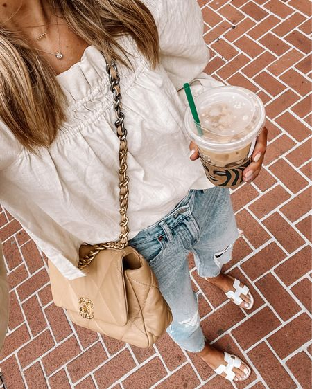 Love this linen puff sleeve top for summer. Pairs perfect with ripped jeans and sandals! Fits TTS http://liketk.it/3hjkI #liketkit @liketoknow.it #LTKstyletip #LTKunder100 #LTKunder50 #summeroutfit #sandals #rippedjeans