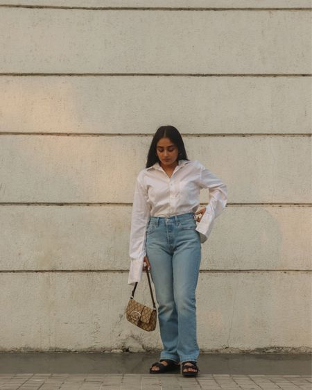 Levi's 501 and button shirt for a dressy casual day @liketoknow.it #liketkit http://liketk.it/3bS8M #LTKstyletip #LTKunder100 #LTKSpringSale