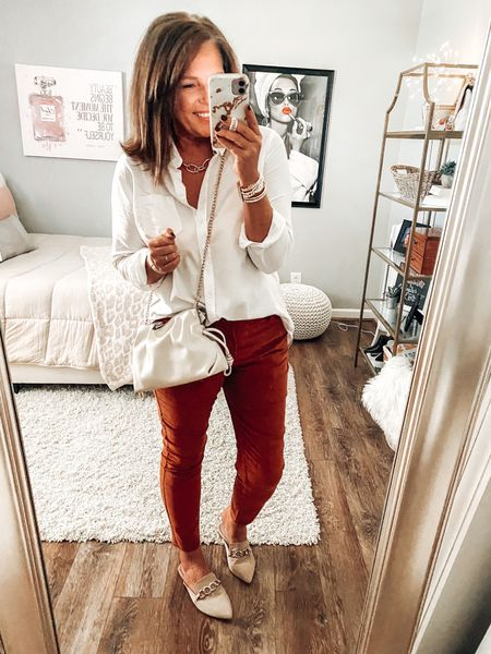 Rust corduroy pants styled with a classic white button down shirt and Steve Madden Chain mules with a fabulous clutch/handbag from Target   Classic style, classic outfit, Steve Madden, corduroy pants, fall outfit, casual outfit, sale  #LTKstyletip #LTKunder50 #LTKsalealert