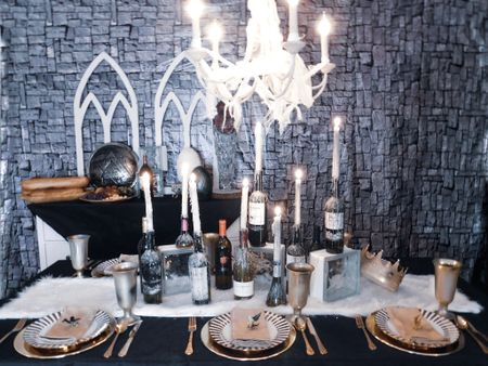 A table set for a king!❄️☺️ I've linked all of the products to make your own GOT table here 👉🏼 http://liketk.it/2BOnv #liketkit @liketoknow.it  The biggest DIY were all of the bottles and even that was super easy!! Just stick some candles in bottles, light them up and go! . . . #houston #houstonblogger #partyblogger #partyinspo #partyblogger  #partystylist #partydesigner #partydecor #gameofthrones #nightking #winteriscoming #whitewalkers #forthethrone #got #gotseason8 #buzzfeed #buzzfeeddiy