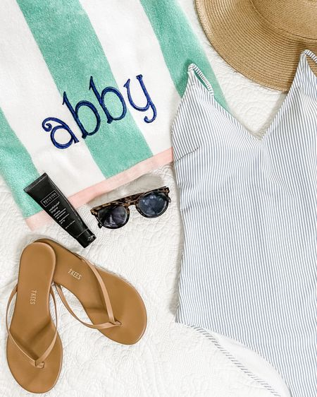 Striped pool towel. Monogrammed beach towel. Tkees neutral sandals. Flip-flops. Seersucker one piece bathing suit. One piece swimsuits. Pool hat. Beach hat. @liketoknow.it http://liketk.it/3htnq #liketkit