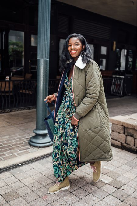 Fall outfit! Long quilted puffer coat, paisley print dress, sage green hiking boots and a striped leather tote I'm pretty fall colors    #LTKtravel #LTKHoliday #LTKGiftGuide