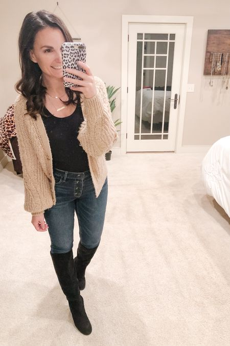 You can get a bodysuit look with a simple fitted tucked tank. I embraced the high waist yesterday. I think owning it is the secret to an outfit looking good!  #highwaistedjeans #tallblackboots #buttonupcardigan   http://liketk.it/34cvi #liketkit @liketoknow.it   You can instantly shop my looks by following me on the LIKEtoKNOW.it shopping app