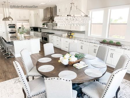 Kitchen at ModernFarmhouseGlam. Neutral area rug, crystal glass chandelier, dining room chairs, ideas for wooden round dining room tables.  #LTKHoliday #LTKhome #LTKSeasonal