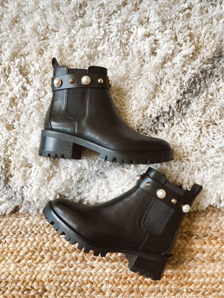 Boots with big soles and embellishments are big this year. Love this comfortable pair with a lower heel and cool details.