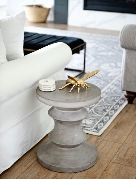 I am absolutely obsessed with a side table! The concrete look with furniture is so in style right now!  Living room furniture, side tables, concrete furniture, modern furniture, fall decor, brass decor, area rug, living room rug, modern rug, bedroom rug, neutral Decor, white sofas, slip covered couch, pottery barn, restoration hardware, living room furniture, washable rug, black Decor, white Decor, black velvet, cocktail ottoman, Amazon home, Amazon finds, target home, target finds  #LTKSeasonal #LTKhome #LTKstyletip