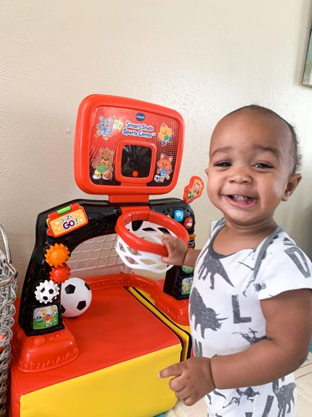 The cutest baby basketball player you ever did see😍 Grey got this little Vtech Basketball goal for his birthday and he LOVES it!  It comes with a basketball for them to shoot in the hoop & a soccer goal that they can kick the ball in💙  This toy is probably one of his favorites from his birthday cause he's always grabbing the ball and playing basketball😭😍 it's fun for us parents to play with too😂 it's under $40 and I highly recommend😌  #ToddlerFinds #FirstBirthdayToys #BoyMama #BoyToys #ToddlerToys #AmazonFinds   #LTKbaby #LTKunder100 #LTKunder50