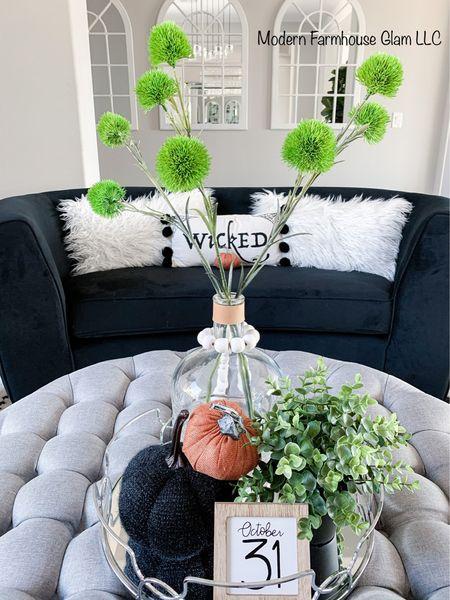 Fall and Halloween season or home decor, tufted ottoman, black velvet loveseat, living room furniture, sitting room furniture, family room, arched mirrors pumpkins ModernFarmhouseGlam   #LTKSeasonal #LTKhome #LTKHoliday