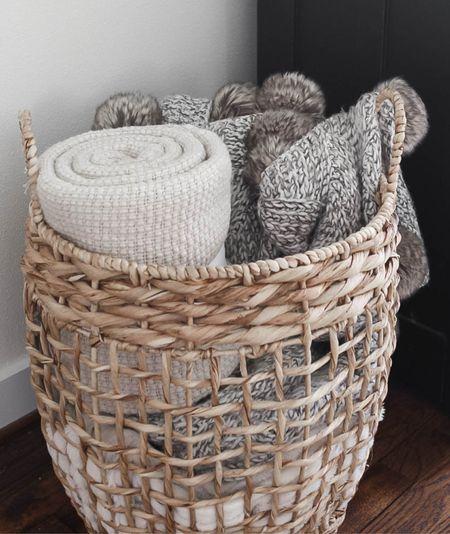 Wicker basket filled with throw blankets. #homedecor #affordabledecor #livingroomdecor #livingroomorganization #organization   #LTKhome #LTKunder50