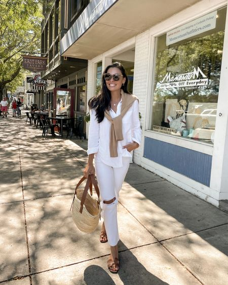White denim jeans and button down with cashmere sweater.