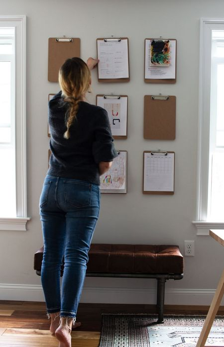 This clipboard wall keeps me organized! I perch on the leather bench when I'm taking notes.  #LTKhome #LTKunder50